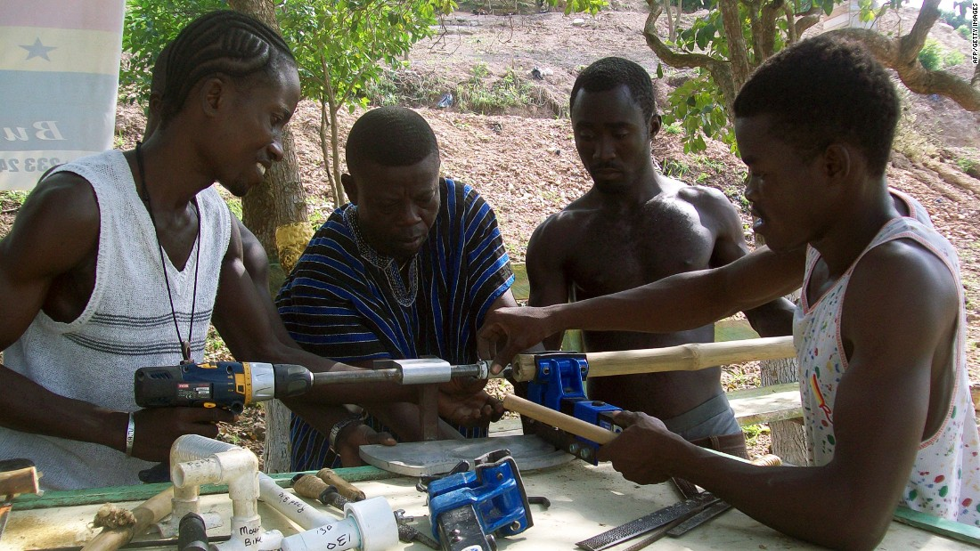 Ghana Bamboo Project CEO Ibrahim Djan Nyampong is showing workers how to make bamboo bicycle frames. Artisans in Ghana make bamboo bikes ranging from mountain racers to cargo bikes for customers in Europe and the U.S.
