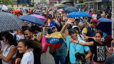 Anti-government demonstrators queue to sign the form to activate the referendum on cutting President Nicolas Maduro's term short, in Caracas on April 27, 2016. Opponents of Venezuelan President Nicolas Maduro hope to hold a referendum on removing him from office as early as November, a leading opposition figure said Wednesday. The center-right opposition has started gathering signatures to launch the first step towards a referendum to get rid of the socialist leader, whom they blame for an economic crisis and rising unrest.  / AFP / FEDERICO PARRA        (Photo credit should read FEDERICO PARRA/AFP/Getty Images)