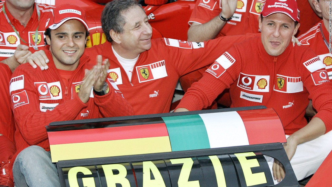Todt (center) toured the globe as team principal of the Ferrari F1 team from 1994 to 2007. Here he is with drivers Felipe Massa (left) and seven-time world champion Michael Schumacher (right) in 2006.