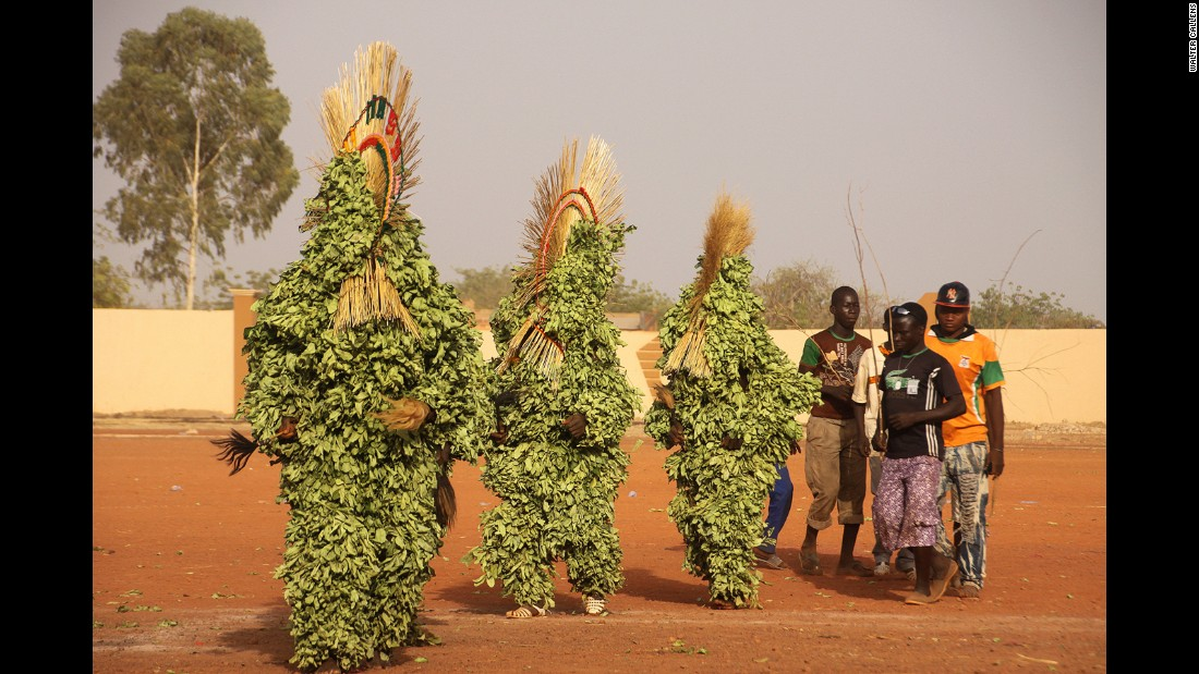 "Among the most striking costumes on show are the masks of the Dafing (Marka) people of Burkina Faso. Covered head to toe in leaves (""koro"") and featuring a crest made from thick dried grass, some believe the masks enhance fertility."