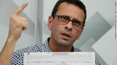 "Venezuelan opposition leader and Miranda State governor Henrique Capriles speaks during a press conference in Caracas on April 26, 2016 after showing the form to activate the referendum on cutting President Nicolas Maduro's term short.  Tension in the recession-racked oil giant has reached the boiling point since the opposition won control of the National Assembly, the biggest threat yet to the socialist ""revolution"" launched by Maduro's late mentor Hugo Chavez in 1999. / AFP / FEDERICO PARRA        (Photo credit should read FEDERICO PARRA/AFP/Getty Images)"