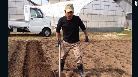 Yoshihide Ito, 63, growing vegetables