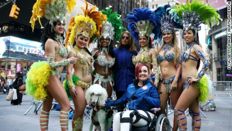 Paralympic equestrian star Sydney Collier poses with samba dancers during Team USA's Road to Rio Tour event.