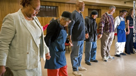 Seventh-day Adventists in prayer.