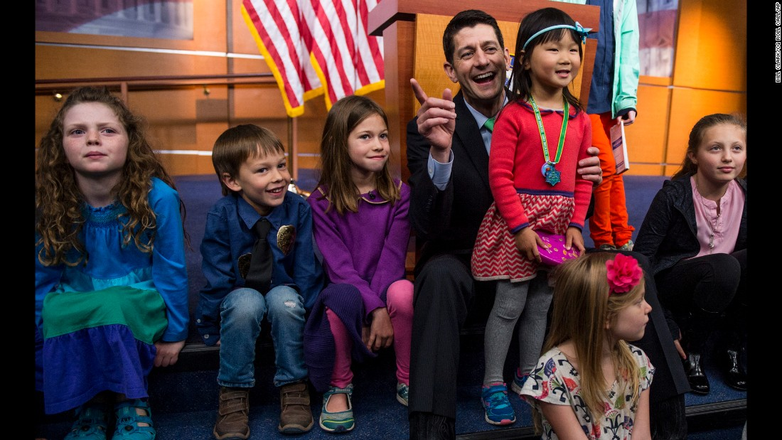 "House Speaker Paul Ryan poses with media members' children after a news conference on ""Take Your Kids to Work Day"" on Thursday, April 28."