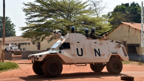United Nations peacekeepers patrol outside a vote-counting centre for the presidential and parliamentary elections on January 2, 2016 in Bangui.  UN troops stood guard over the main vote-counting centre in Bangui on December 31, 2015 after a peaceful election in the Central African Republic aimed at turning the page on years of inter-religious violence. / AFP / ISSOUF SANOGO        (Photo credit should read ISSOUF SANOGO/AFP/Getty Images)