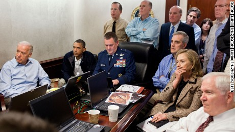 President Barack Obama and Vice President Joe Biden, along with members of the national security team, receive an update on the mission against Osama bin Laden in the Situation Room of the White House, May 1, 2011.