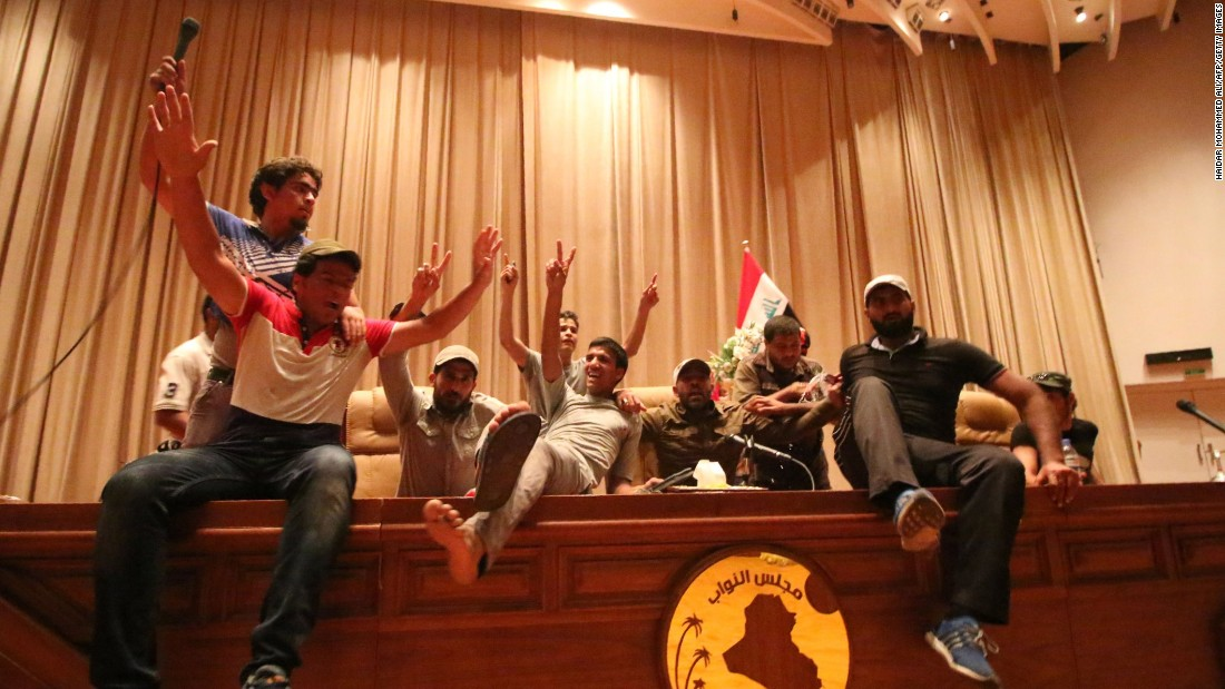 Protesters pull out of Baghdad's Green Zone but vow to be back