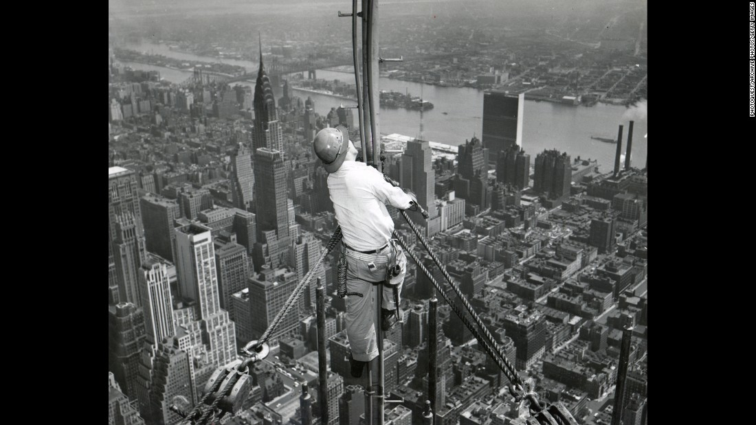 A worker attaches the temporary television antenna in 1950. A year later, the building is sold for $34 million.