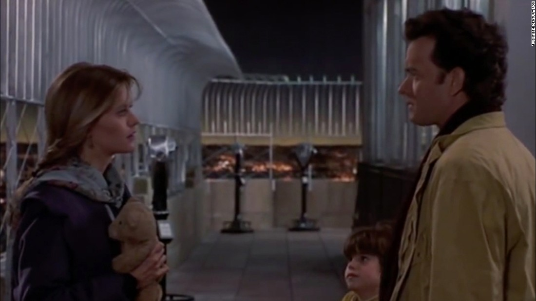 "Actors Meg Ryan, Ross Malinger, center, and Tom Hanks are seen on the observation deck of in a scene from the 1993 film ""Sleepless in Seattle."" The building has been featured in several movies such as ""An Affair to Remember,"" ""Elf,"" and ""The Amazing Spider-Man."""