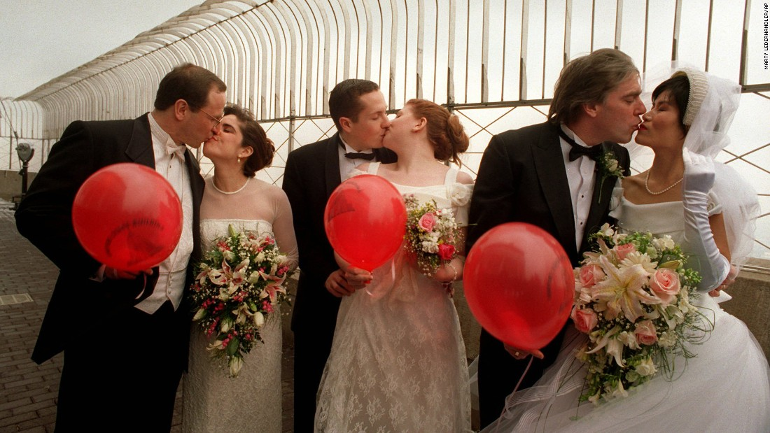Couples kiss on the observation deck after participating in the Valentine's Day marriage marathon on February 14, 1996. Every year on Valentine's Day, couples who marry on the 80th floor become members of the Empire State Building Wedding Club. They receive free admission to the observatory each year on February 14 (their anniversary) thereafter.