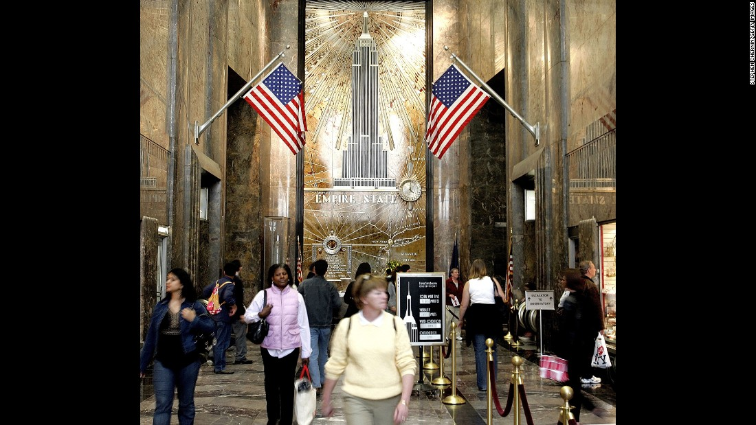 People walk through the lobby of the Empire State Building on its 75th anniversary on May 1, 2006.