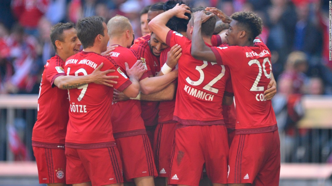 Serdar Tasci (C) of Bayern Munich celebrates scoring his team's first goal with his teammates.