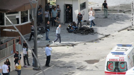 Police officers examine the scene outside the police headquarters in Gaziantep after the blast.