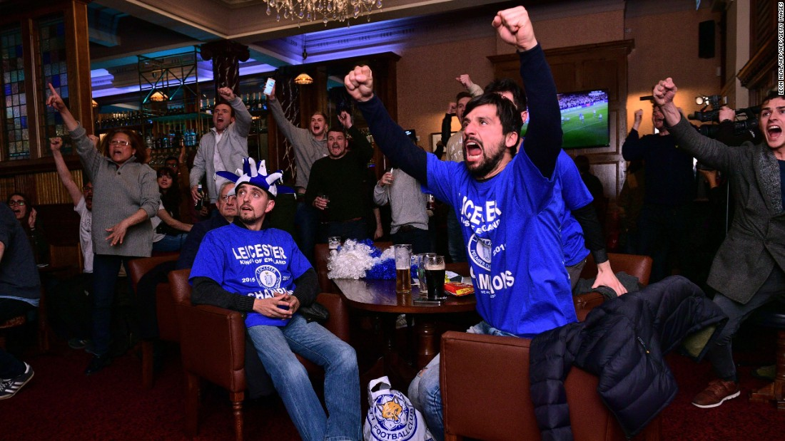 Leicester City fans watch the Chelsea-Tottenham match at a pub in Leicester, England, on Monday, May 2. The match ended 2-2, giving Leicester City its first Premier League title in club history. The Foxes were a 5,000-to-1 shot when the season started.