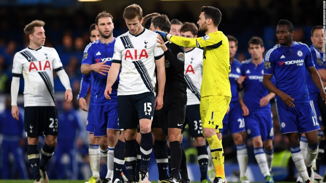 Chelsea and Tottenham players scuffle after Tottenham's Eric Dier, front, brought down Hazard.