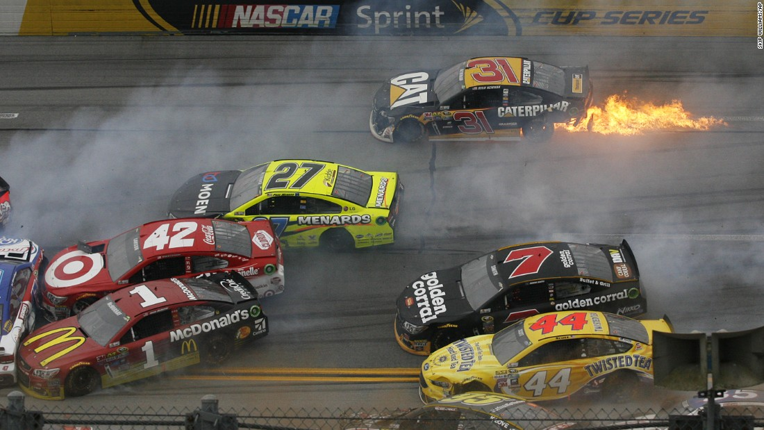 Flames trail from the car of Sprint Cup driver Ryan Newman during a pileup crash in Talladega, Alabama, on Sunday, May 1. More than a dozen cars were involved in the wreck. Nobody was seriously hurt.
