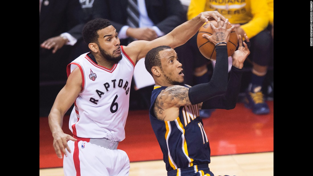Toronto's Cory Joseph rejects Indiana's Monta Ellis during Game 7 of their NBA playoff series on Sunday, May 1. Toronto won 89-84 to advance to the second round.