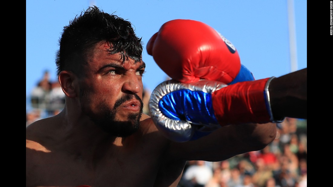 Victor Ortiz avoids a punch by Andre Berto during their welterweight bout in Carson, California, on Saturday, April 30. Berto stopped Ortiz in the fourth round.
