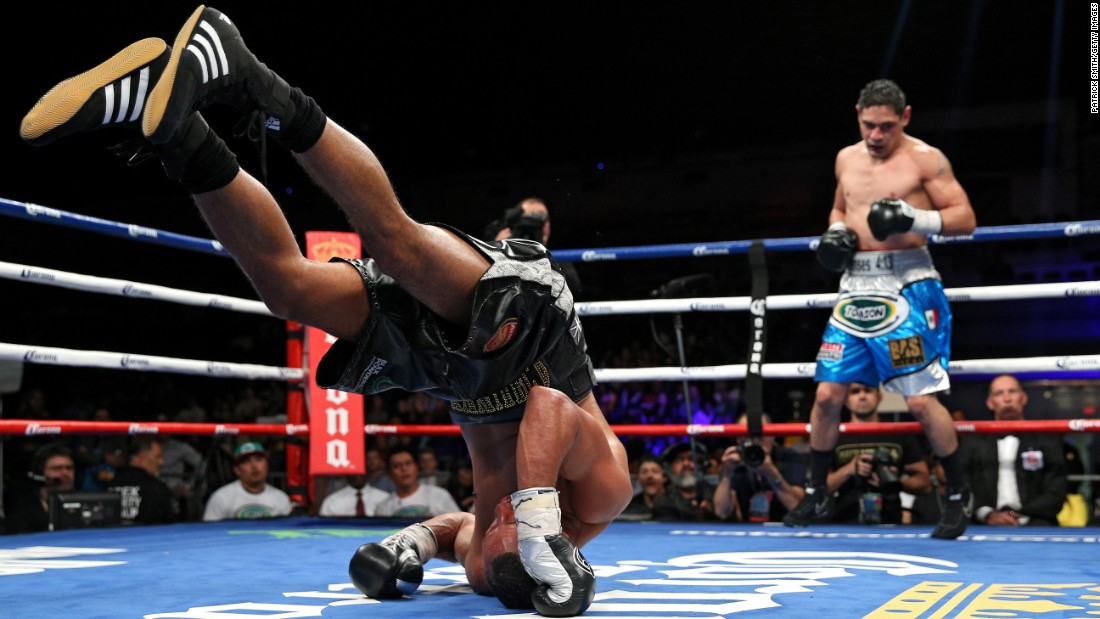 James DeGale rolls backward after losing his footing in Washington on Saturday, April 30. DeGale recovered to win a unanimous decision over Rogelio Medina.