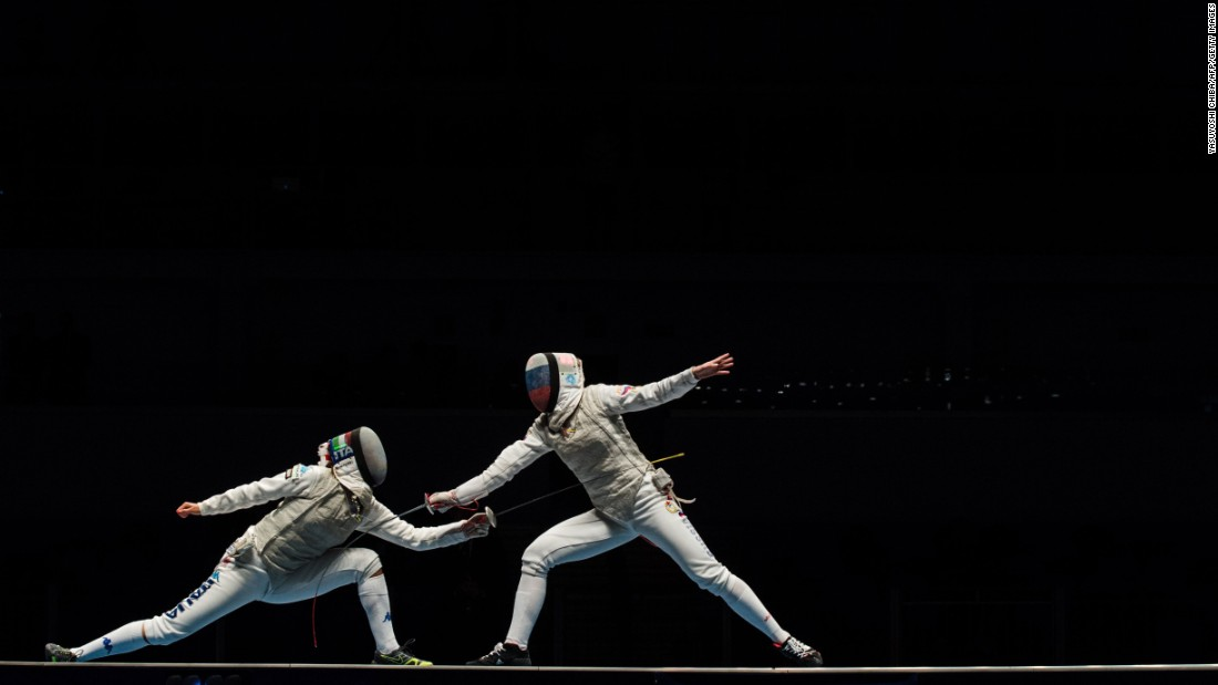 Italian fencer Arianna Errigo, left, competes against Russia's Inna Deriglazova during the Fencing World Championships on Tuesday, April 26. Russia's women won gold in the team foil event.