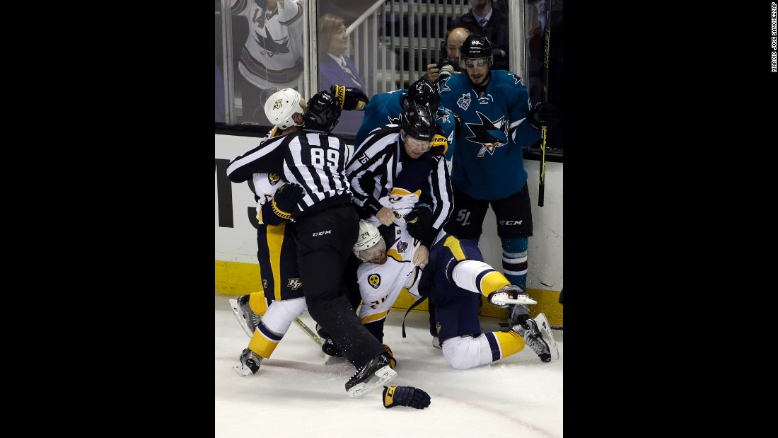 Members of the Nashville Predators and the San Jose Sharks fight at the end of an NHL playoff game on Saturday, April 30. The Sharks had just won Game 1 of the second-round series.