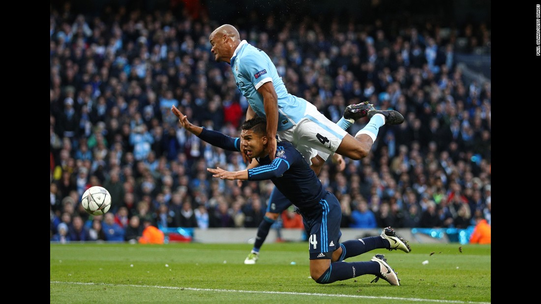 Manchester City defender Vincent Kompany, top, collides with Real Madrid's Casemiro on Tuesday, April 26, during the first leg of their Champions League semifinal. The match ended scoreless in Manchester, England.