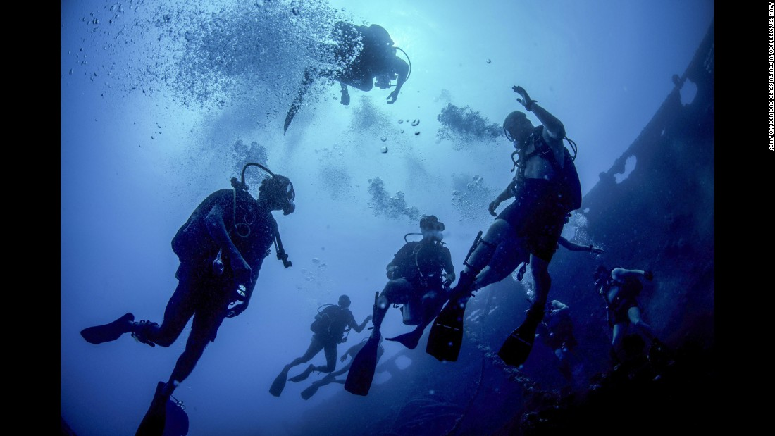 Sailors from the United States and Sri Lanka swim near the Tokai Maru, a sunken Japanese freighter from World War II, during a diving exercise in Guam on Wednesday, April 13.