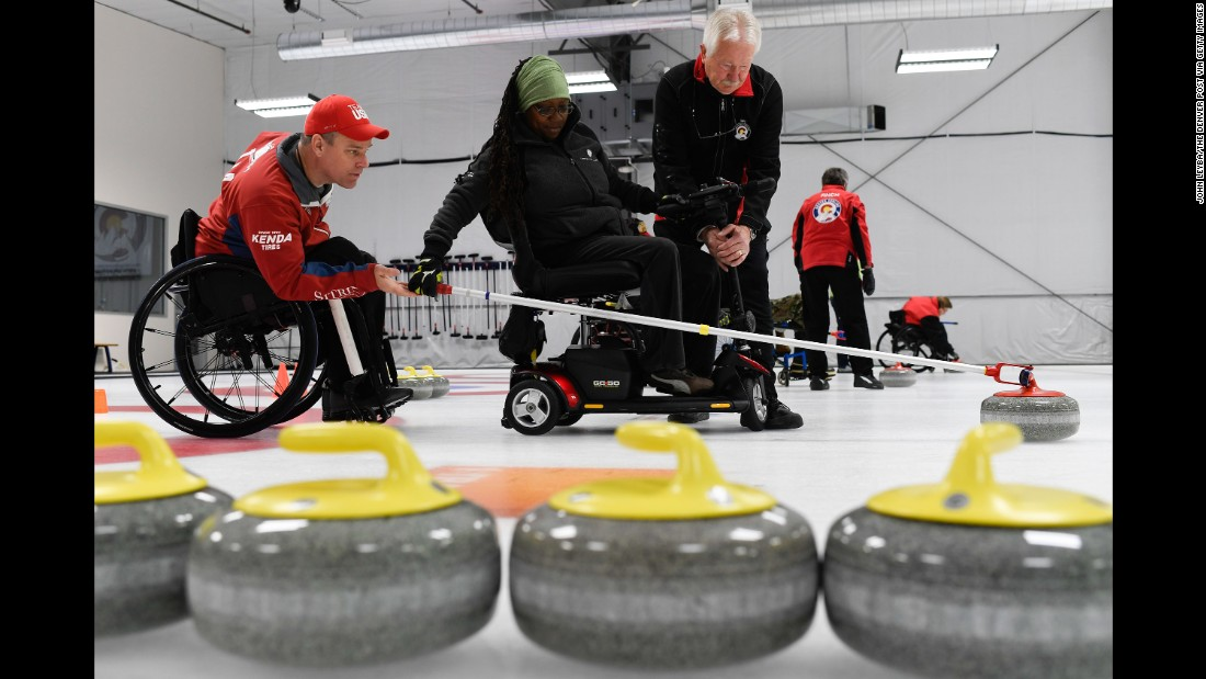 Disabled U.S. veterans take part in a curling camp in Denver on Thursday, April 14.