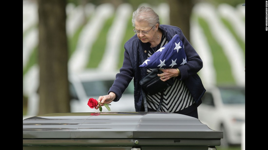 Urbana Warfel, 81, places a rose on the casket of her brother, Army Sgt. Wilson Meckley Jr., during his burial ceremony Monday, April 4, at Arlington National Cemetery. Meckley, from Lancaster, Pennsylvania, was declared dead during the Korean War, but his body was never found. Through DNA testing, it was determined that his remains were among those returned to the United States between 1990 and 1994.