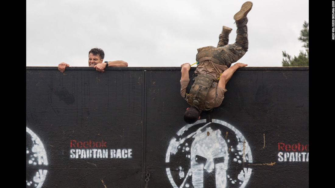 Army soldiers climb over an 8-foot wall in Fort Mitchell, Alabama, as they take park in the 33rd annual Best Ranger Competition on Saturday, April 16. The three-day event tested competitors' physical, mental and technical capabilities.