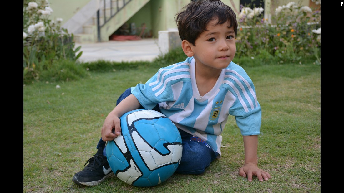 Murtaza Ahmadi, 5, gained worldwide fame after being photographed wearing a plastic bag with Lionel Messi's name on it. He and his family have fled rural Afghanistan for Pakistan after receiving threats, his father told CNN.