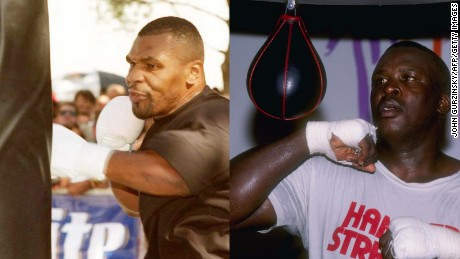 Mike Tyson (L) and Buster Douglas (R)
