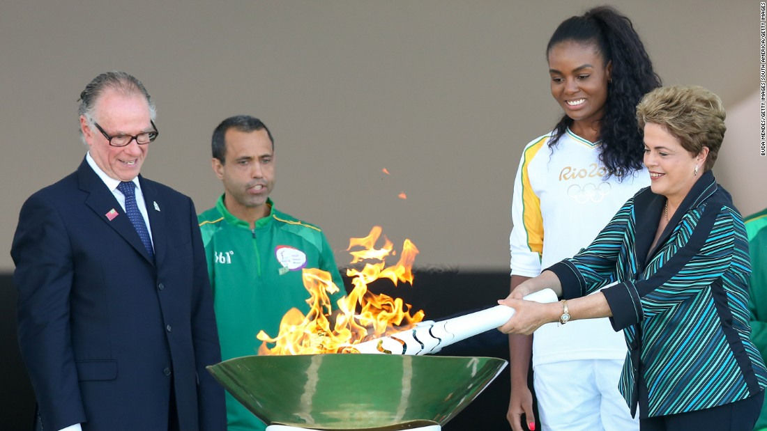 Brazilian president Dilma Rousseff lit the Olympic torch in Brasilia Tuesday. The  torch will pass through 329 cities on its way to Rio de Janeiro where the Games begin on August 5.