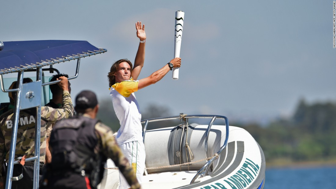 Brazilian sailor Felipe Rondina carried the Olympic flame on a speedboat at Lake Paranoa.
