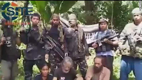 A screengrab from a video obtained by extremist monitoring organization SITE purportedly shows three hostages held by Abu Sayyaf.
