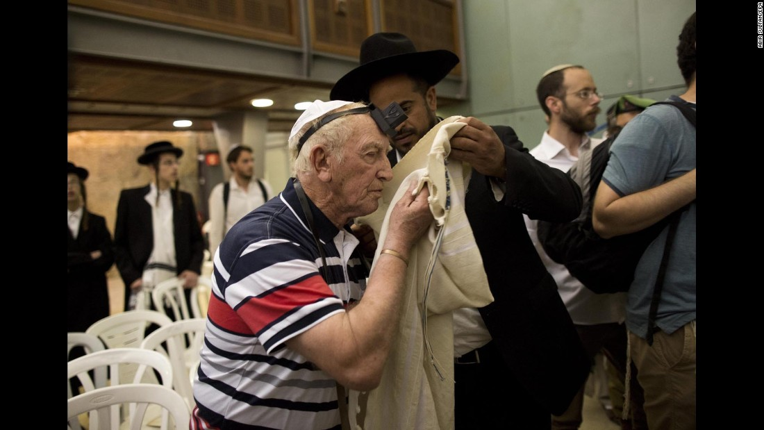 Some 50 Holocaust survivors who never celebrated their bar mitzvahs marked the special occasion with their families at the Western Wall in Jerusalem before Israel's Holocaust Memorial Day.