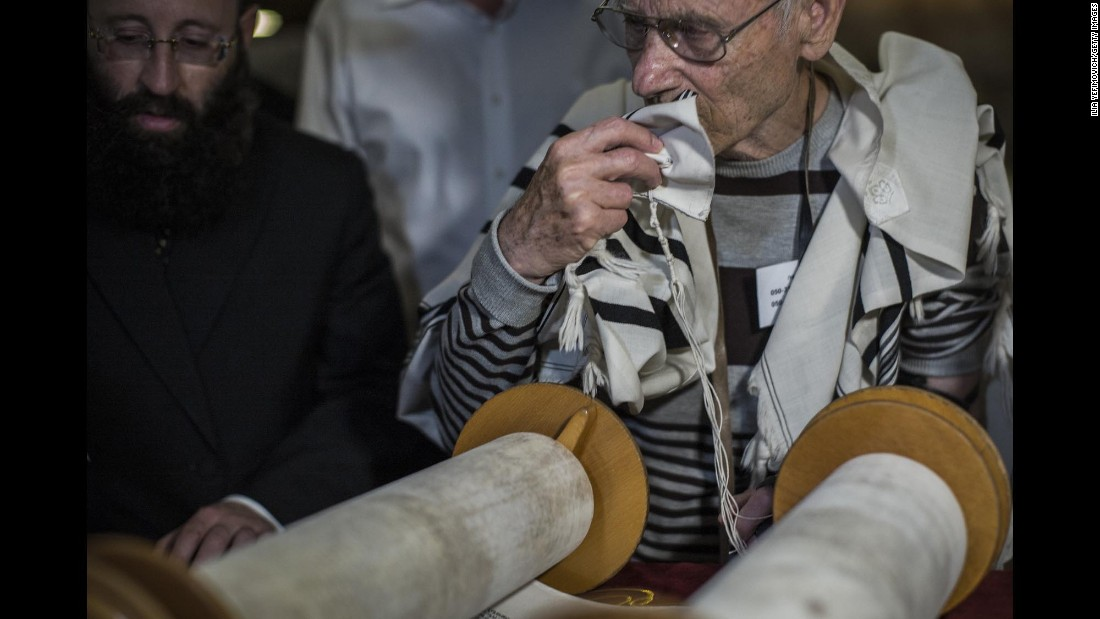 Reading from the Torah is preceded and followed by prayers. Observant Jews touch the scroll with their prayer shawls, then kiss the shawls as a sign of respect.