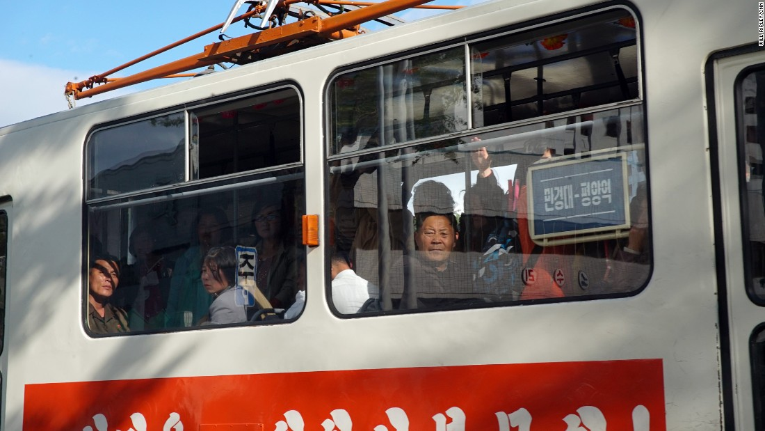 Passengers look curiously through the window at foreign journalists who are taking pictures of them on a tram in Pyongyang, May 4.