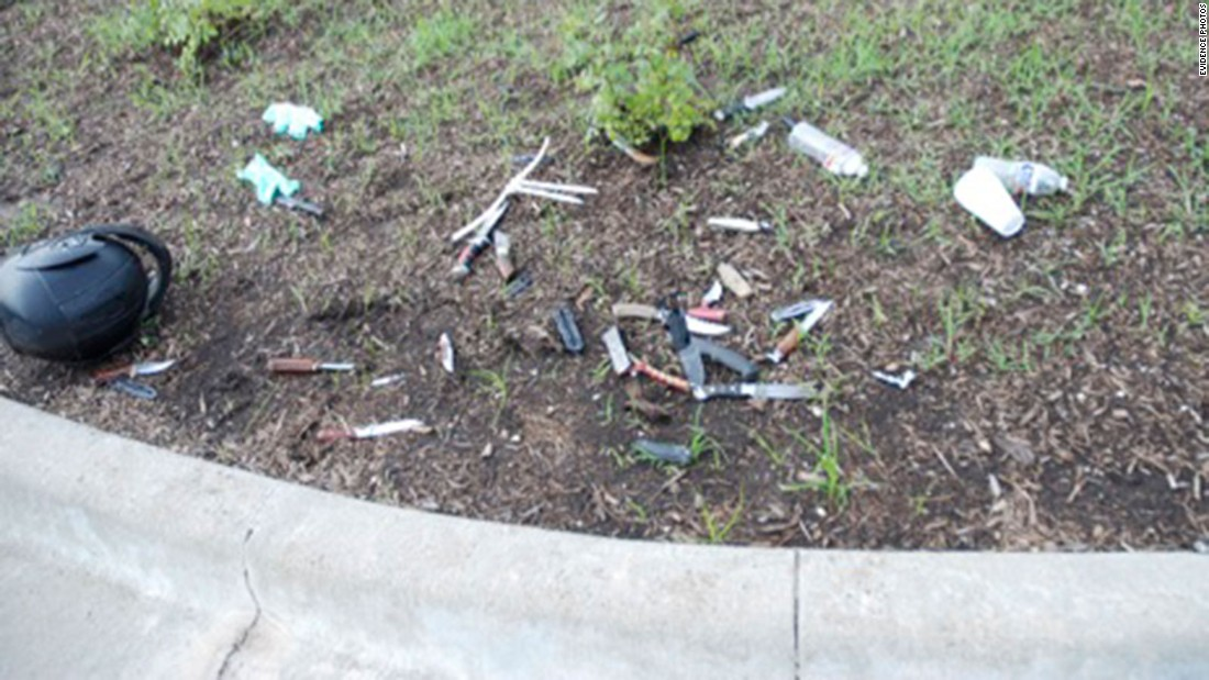 Knives and weapons are thrown across the dirt and weeds in the Twin Peaks parking lot.