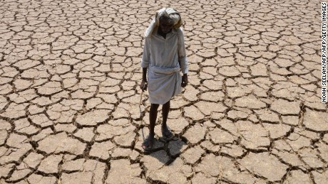 An Indian farmer poses in his dried up cotton field at Chandampet Mandal in Nalgonda east of Hyderabad on April 25, 2016, in the southern Indian state of Telangana. Some 330 million people are suffering from drought in India, the government has said, as the country reels from severe water shortages and desperately poor farmers suffer crop losses. / AFP / Noah SEELAM        (Photo credit should read NOAH SEELAM/AFP/Getty Images)