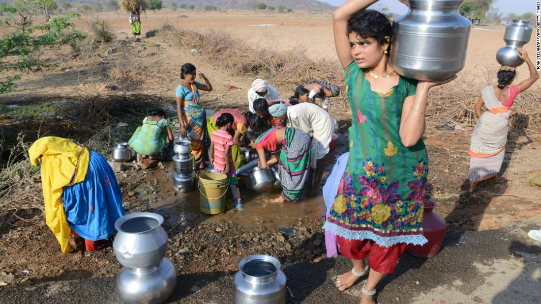 Villagers fill drinking water from a leaking roadside pipe in Nalgonda on April 25.