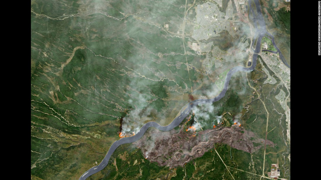 The wildfire burns through northern Alberta in this image released by NASA on May 3.