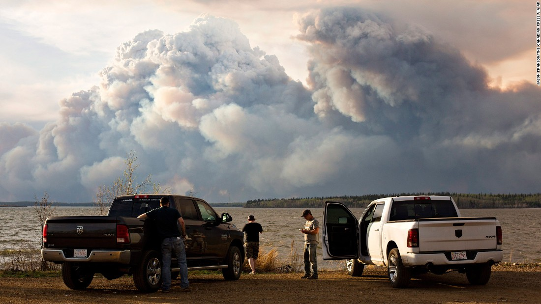 Evacuees watch the wildfire near Fort McMurray on May 4.
