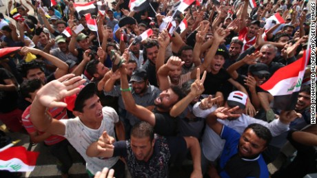"Iraqi protesters gather in the parade grounds outside the parliament in Baghdad's heavily fortified ""Green Zone"" on May 1, 2016, a day after supporters of Shiite cleric Moqtada al-Sadr broke into the area after lawmakers again failed to approve new ministers. Protesters were withdrawing from Baghdad's Green Zone after breaking into the fortified area and storming Iraq's parliament in an unprecedented security breach the day before. The move, which lessens the pressure on politicians in Baghdad, came as rare bombings in the south killed 33 people and wounded dozens. / AFP / HAIDAR MOHAMMED ALI        (Photo credit should read HAIDAR MOHAMMED ALI/AFP/Getty Images)"