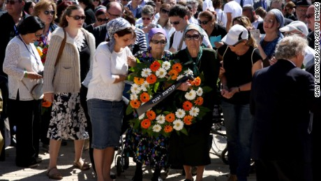 Israeli holocaust survivors who survived Auschwitz death camp place a wreath during a ceremony marking the annual Holocaust Remembrance Day at the Yad Vashem Holocaust Memorial in Jerusalem on May 5, 2016. The state of Israel marks the annual Memorial Day commemorating the six million Jews murdered by the Nazis in the Holocaust during World War II. / AFP / GALI TIBBON        (Photo credit should read GALI TIBBON/AFP/Getty Images)