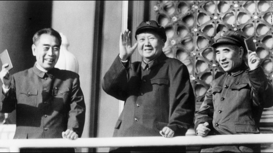China's leaders during the Cultural Revolution: Premier Zhou Enlai, Chairman Mao Zedong and Defense Minister Lin Biao wave during a military parade on Tiananmen Square.