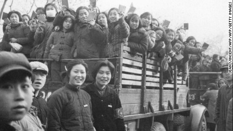"""The Red Guards, high school and university students, brandishing the copies of Chairman Mao Zedong's """"Little Red Book"""" in Beijing in 1966."""