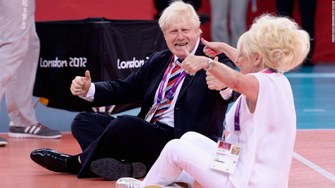 Johnson and actress Barbara Windsor play sitting volleyball after a Paralympics match in London on August 31, 2012.