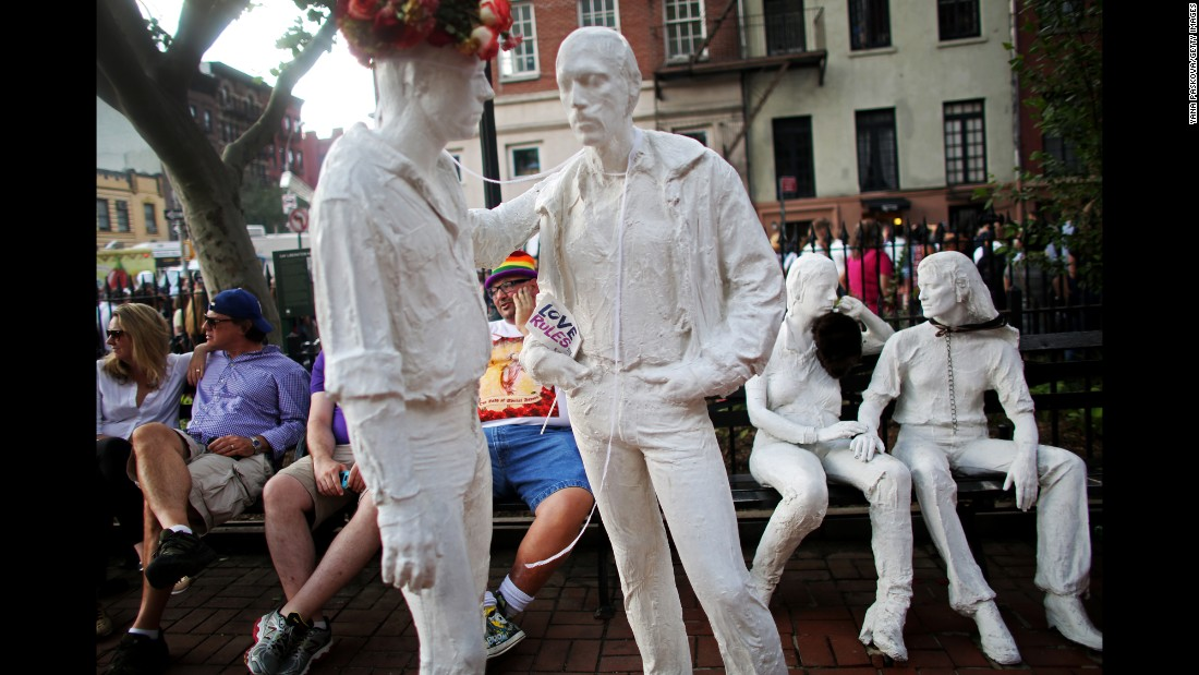 "<a href=""http://www.nycgovparks.org/parks/christopher-park/monuments/575"" target=""_blank"">Artist George Segal's ""Gay Liberation""</a> sculpture at Christopher Park is located opposite the Stonewall Inn. The work, featuring two standing men and two seated women, was unveiled in 1992."